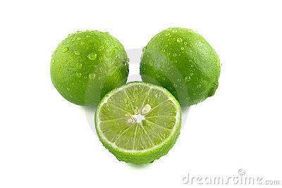Green lemon with water droplets