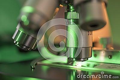 Green Light Falling On Microscope Lens