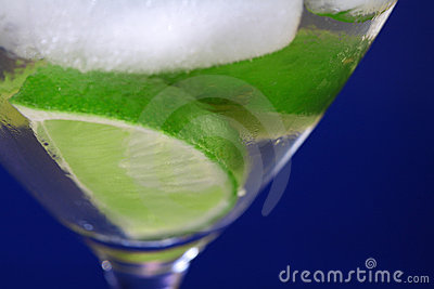 Green lime in the glass of cold sparkling water