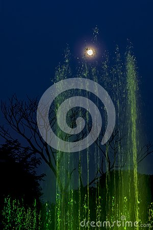 Free Green Lit Fountain, Touching The Full Moon On The Sky Royalty Free Stock Image - 135970216