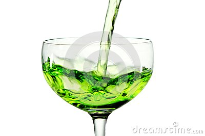Green martini cocktail into glass on white backgro