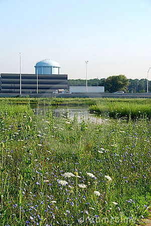 Green meadow and office buildings