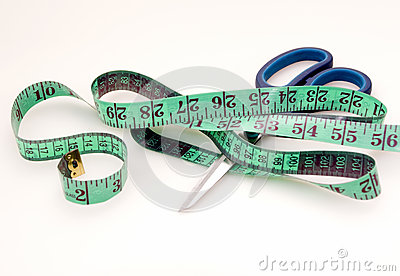 Green measuring tape and scissors