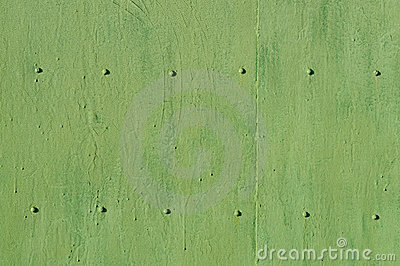 Green metal background with bolts