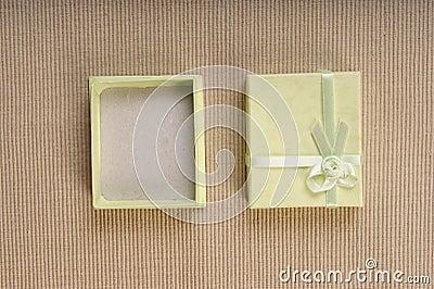 Green mini gift box with ribbon