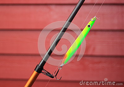 Green neon fishing hook on a fishing rod royalty free for Green fishing rod