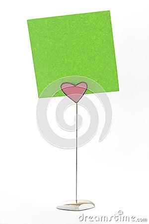 Green notes on heart shape holder