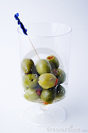 Green olives in a glass