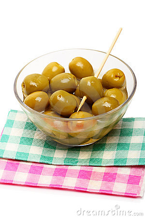 Green olives on napkins