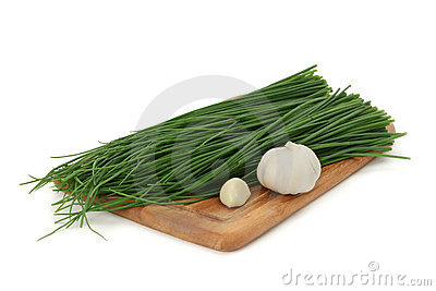 Green onion, garlic on a board