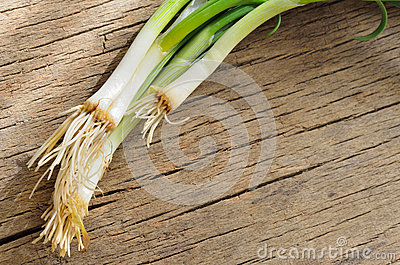 Green onion on wood