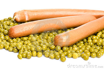 Green peas with frankfurter close up