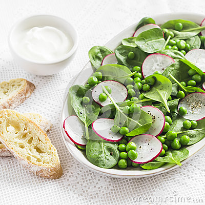 Free Green Peas, Radish And Baby Spinach Salad On Ceramic Plate On A Light Background. Royalty Free Stock Images - 68953489