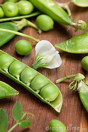 Green peas on wood board