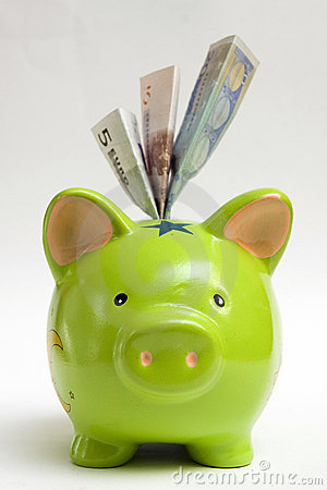 Green piggy bank and money