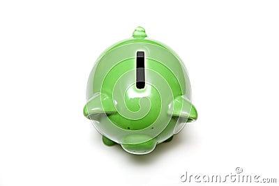 Green piggy bank on white