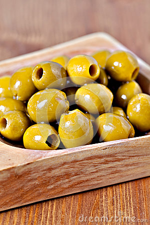 Green pitted marinated olives