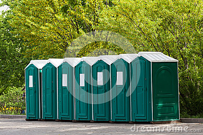 Green plastic toilet booths