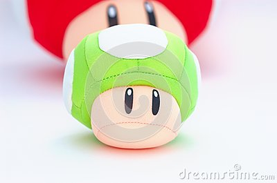 Green plush mushroom with red at the back on white