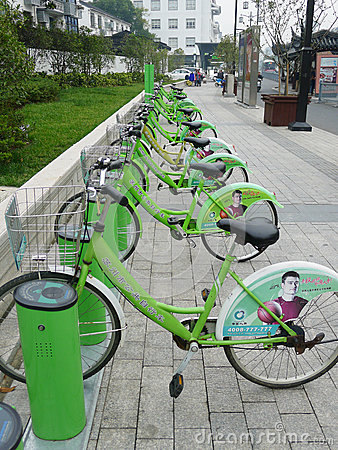 Green Public bicycles in Suzhou Editorial Image