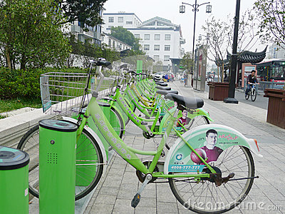 Green Public bicycles in Suzhou Editorial Stock Photo