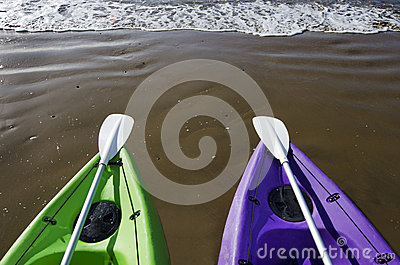 Green and Purple Kayaks on Beach