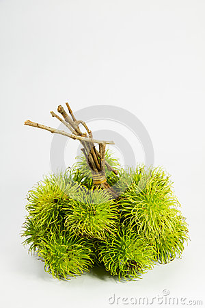 Green rambutan on white backgruond.