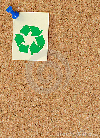 Green recycle symbol on corkboard