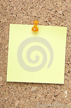 Green reminder note with orange pin
