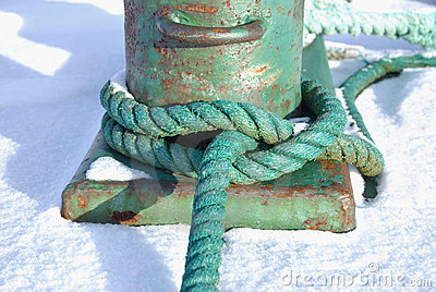 Green Rope Knotted Around a Bollard