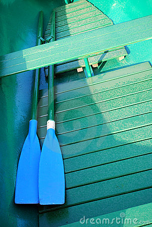 Green Rowboat with blue Oars
