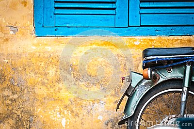 Scooter parked at old building in Vietnam, Asia.