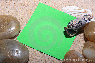 Green scratch paper on sand