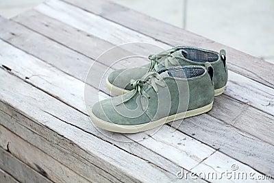 Green shoe on wood