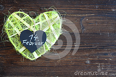 Green sisal heart on wood