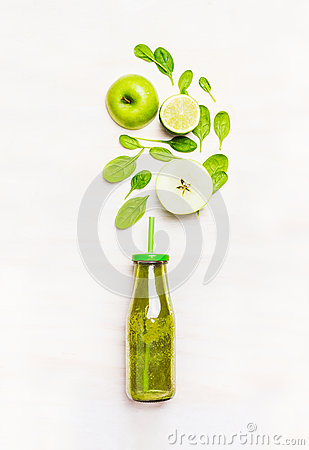 Free Green Smoothie Drink In Bottle With Straw  And  Ingredients ( Spinach,apple, Lime )  On White Wooden Background Royalty Free Stock Image - 66993236