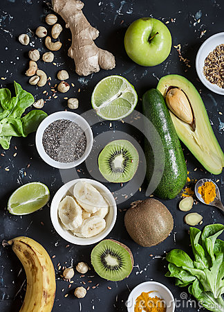 Free Green Smoothie Ingredients. Cooking Healthy Detox Smoothies. On A Dark Background Royalty Free Stock Images - 78768539