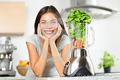 Green smoothie woman making vegetable smoothies
