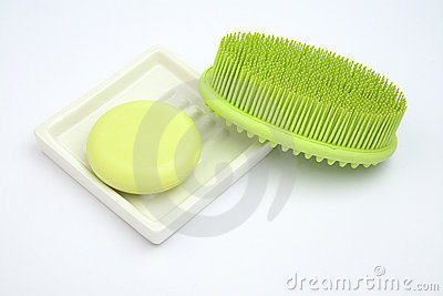 Green Soap in soap-dish with green rubber brush