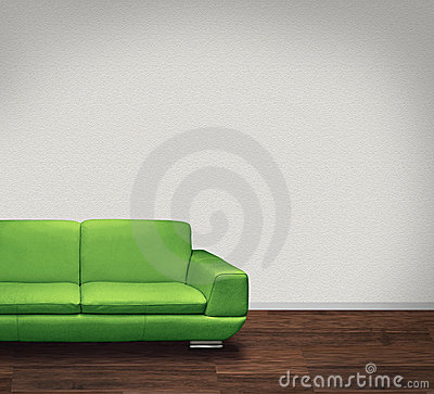 Green sofa in white room