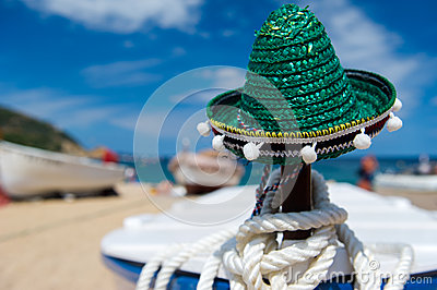 Green Spanish straw hat at beach