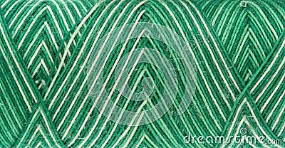 Green spool of thread
