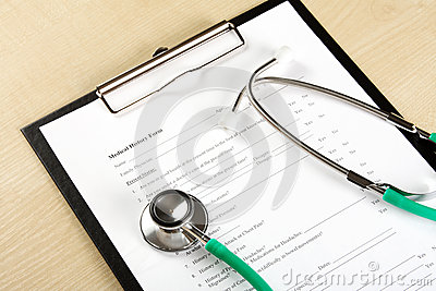 Medical concept of green stethoscope lying on a medical record (medical history)
