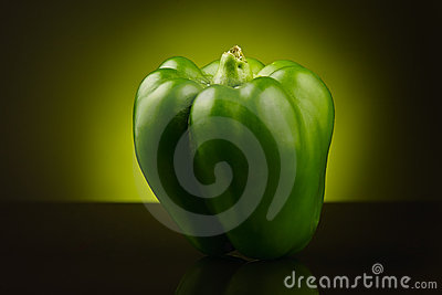 Green sweet pepper on yellow-green background