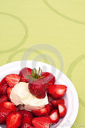 Green tablecloth with red strawberries
