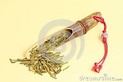Green tea with bamboo spoon