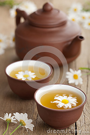 Green tea with chamomile flowers