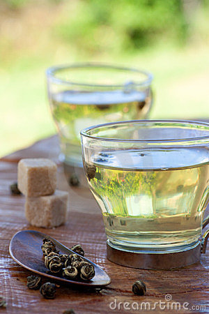 Free Green Tea Infuser With Sugar Cubes Royalty Free Stock Photo - 24013115