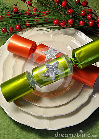 Green theme Christmas dining table setting with fine china plates and Christmas Bon Bon Crackers
