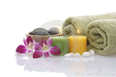Green Towel, Orchid, Candles and Pebbles on white background